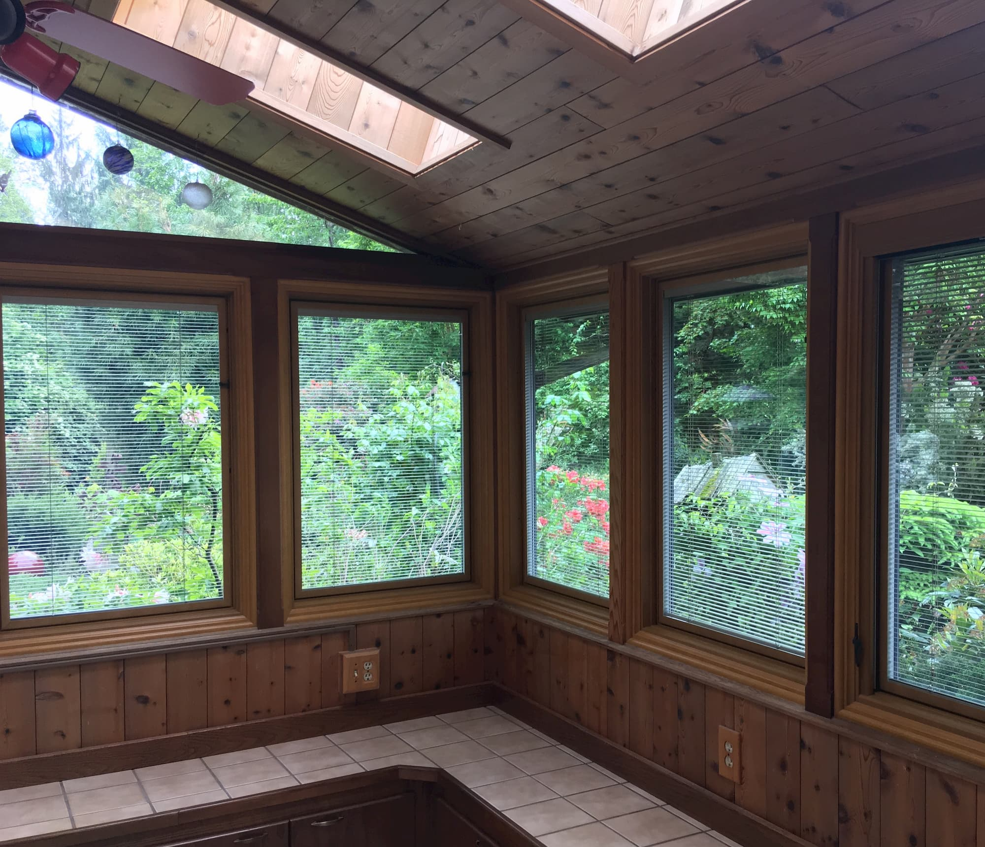 New Pella windows with between-the-glass blinds installed in a sun room.