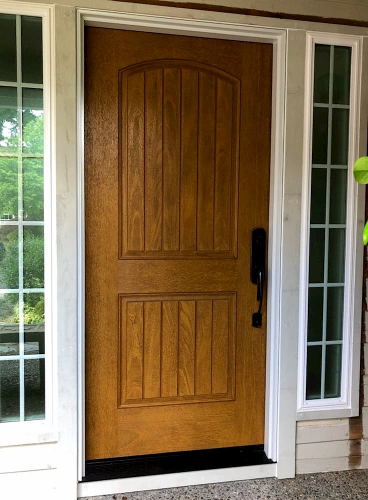 Wood-look Plank 2 Panel Arch fiberglass entry door flanked by two sidelights