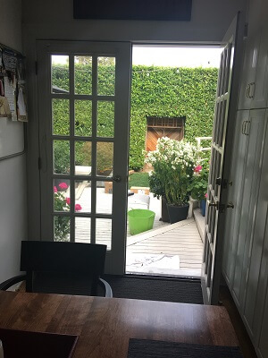 before image of seattle home with new wood patio door and wood double hung window