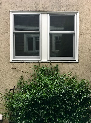 window view of seattle home with new wood double hung window and wood patio door