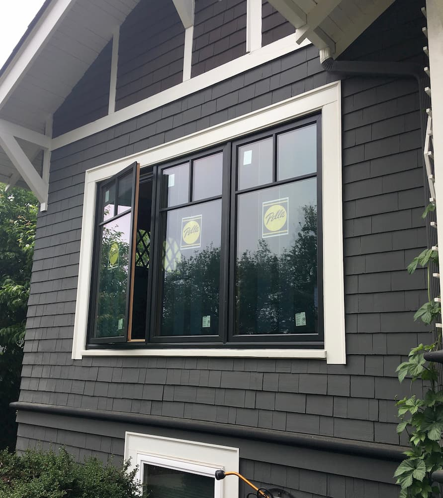 Exterior view of home with three new wood casement windows from Pella