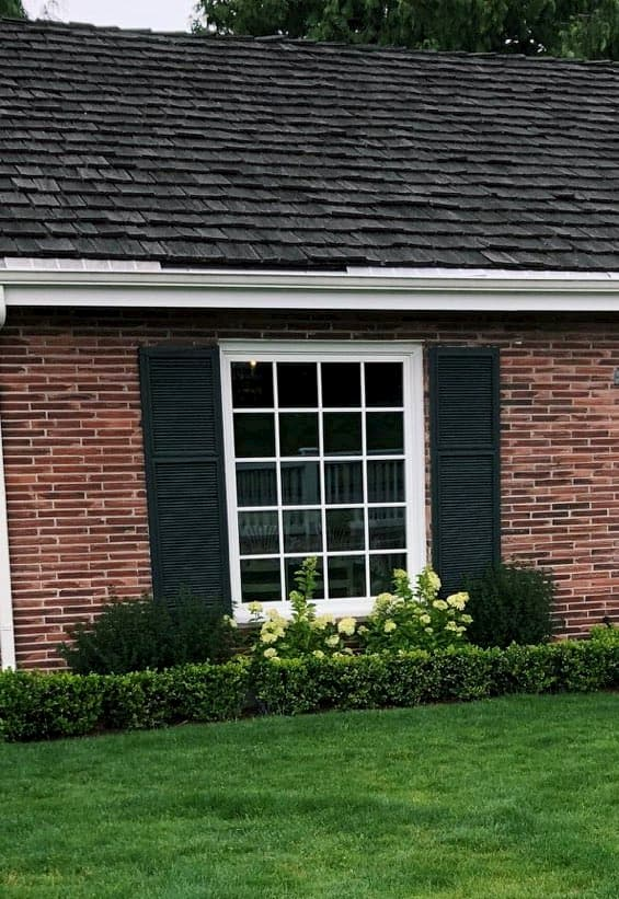 New vinyl picture window with traditional grille pattern on a brick home