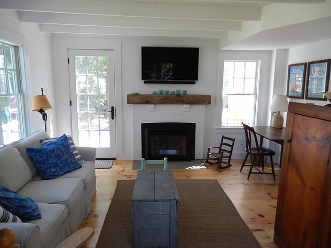 Living room in Cape Cod cottage with new wood windows