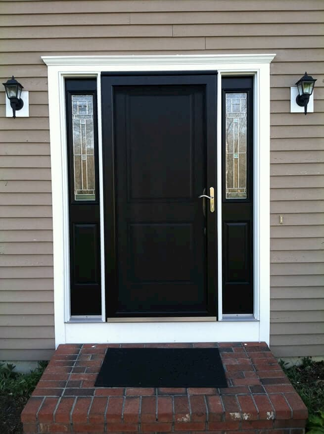 Black entry door system with storm door and sidelights