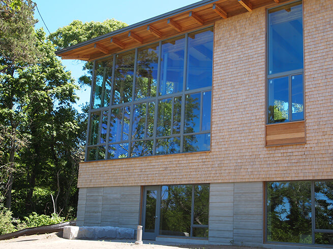 Wall of Architect Series Contemporary windows on modern Eastham Public Libary addition