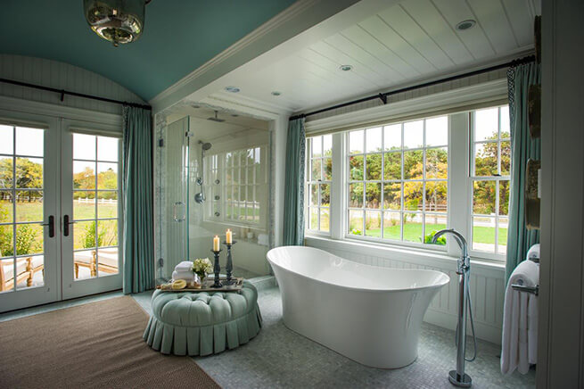 Bathroom with large windows and French patio doors in the 2015 HGTV Dream Home in Martha's Vineyard