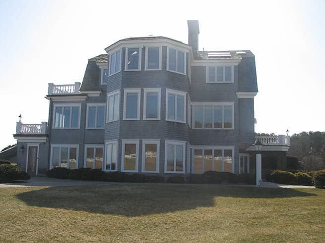 Exterior view of shingle-style home with all-new Pella casement windows