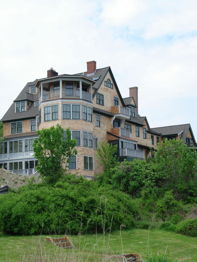 Back side of Bancroft on the Bluffs window replacement project in Newport County, Rhode Island