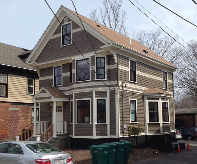 Black double-hung and bay windows on the back of The Attwater in Newport, RI