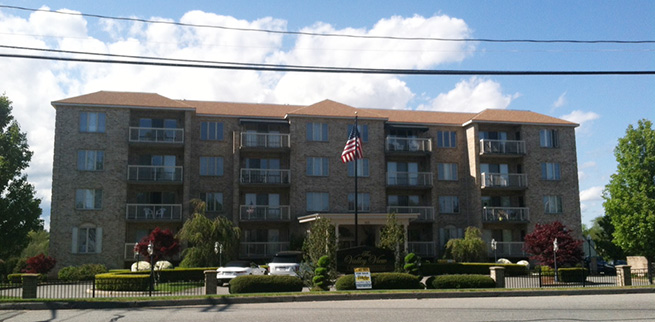 Full exterior view of Valley View Condos with new Impervia fiberglass windows
