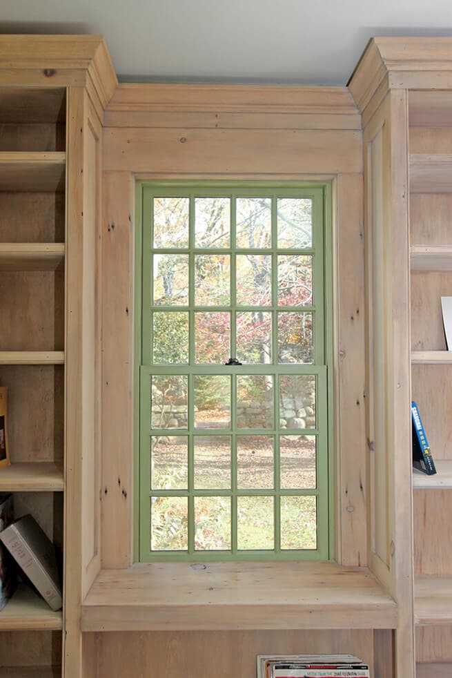 Interior view of wood double-hung window with sage green finish