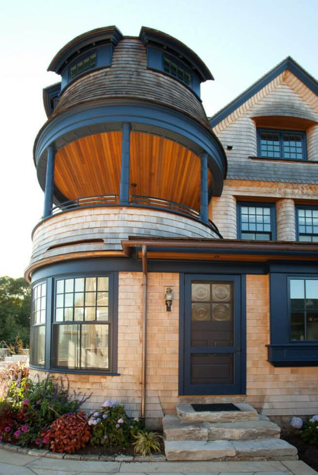 Side entry door and curved windows on waterfront residence on the South Coast of Rhode Island