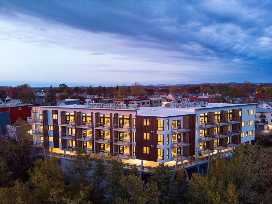 One Lakeview Apartments in Burlington, Vermont, with new windows lit up at dusk