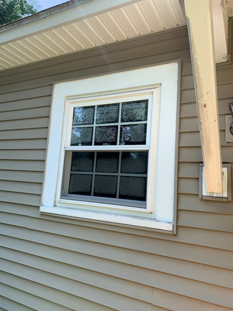 double hung window with broken seal