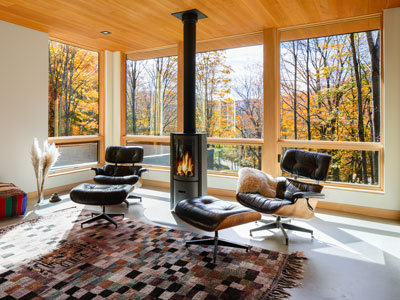 Contemporary Windows and Patio Doors Capture Scenery at Mad River Guesthouse