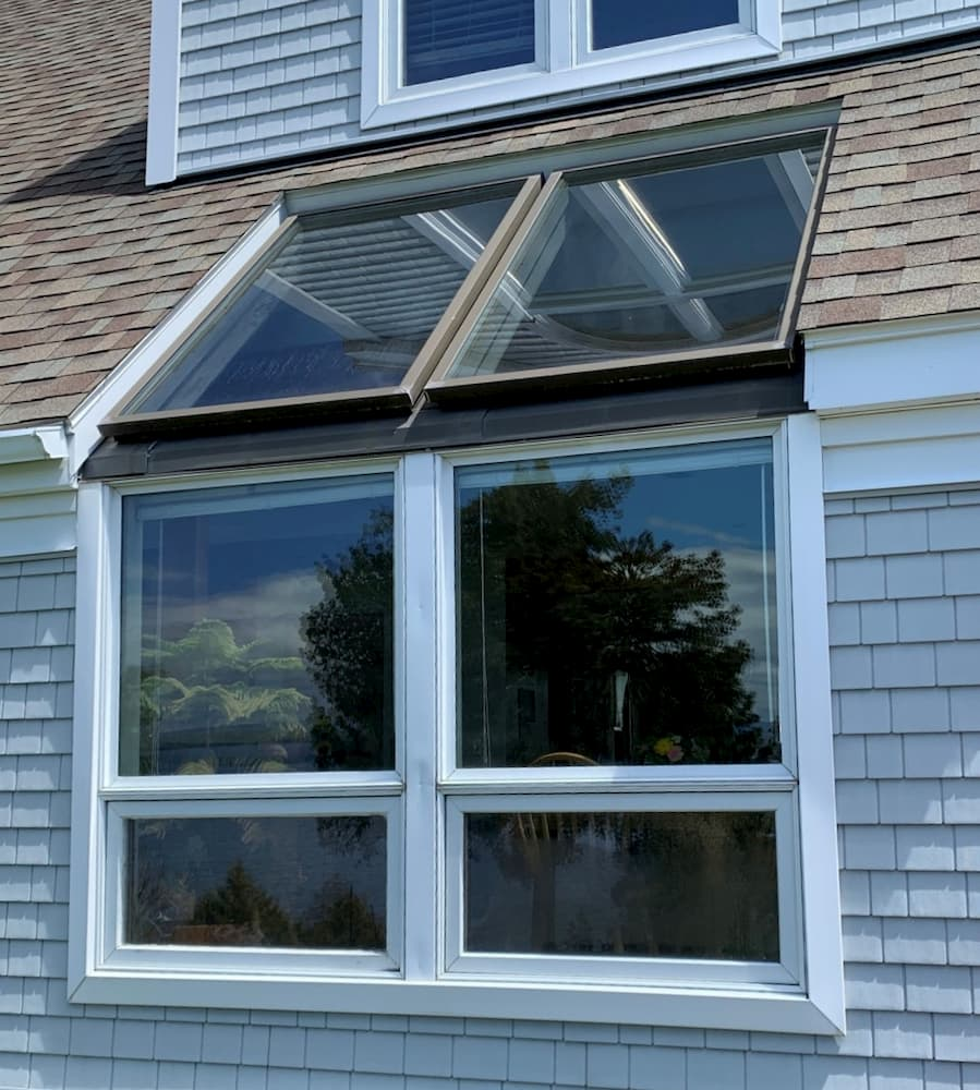 Exterior view of old dining room window bumpout on a shingle-style home