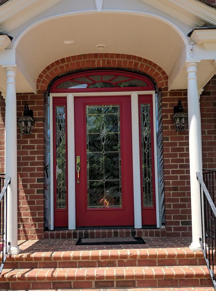 New red entry door with art glass and sidelights