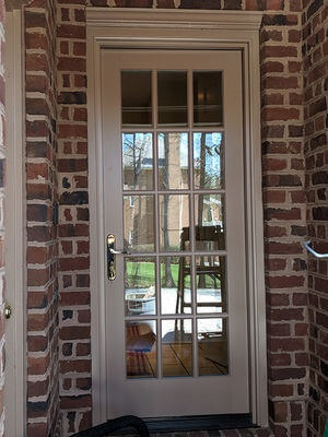 hinged patio door on brick home