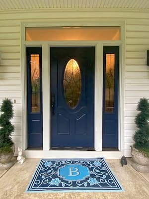 New Door with Decorative Glass and Sidelights Brightens Entry