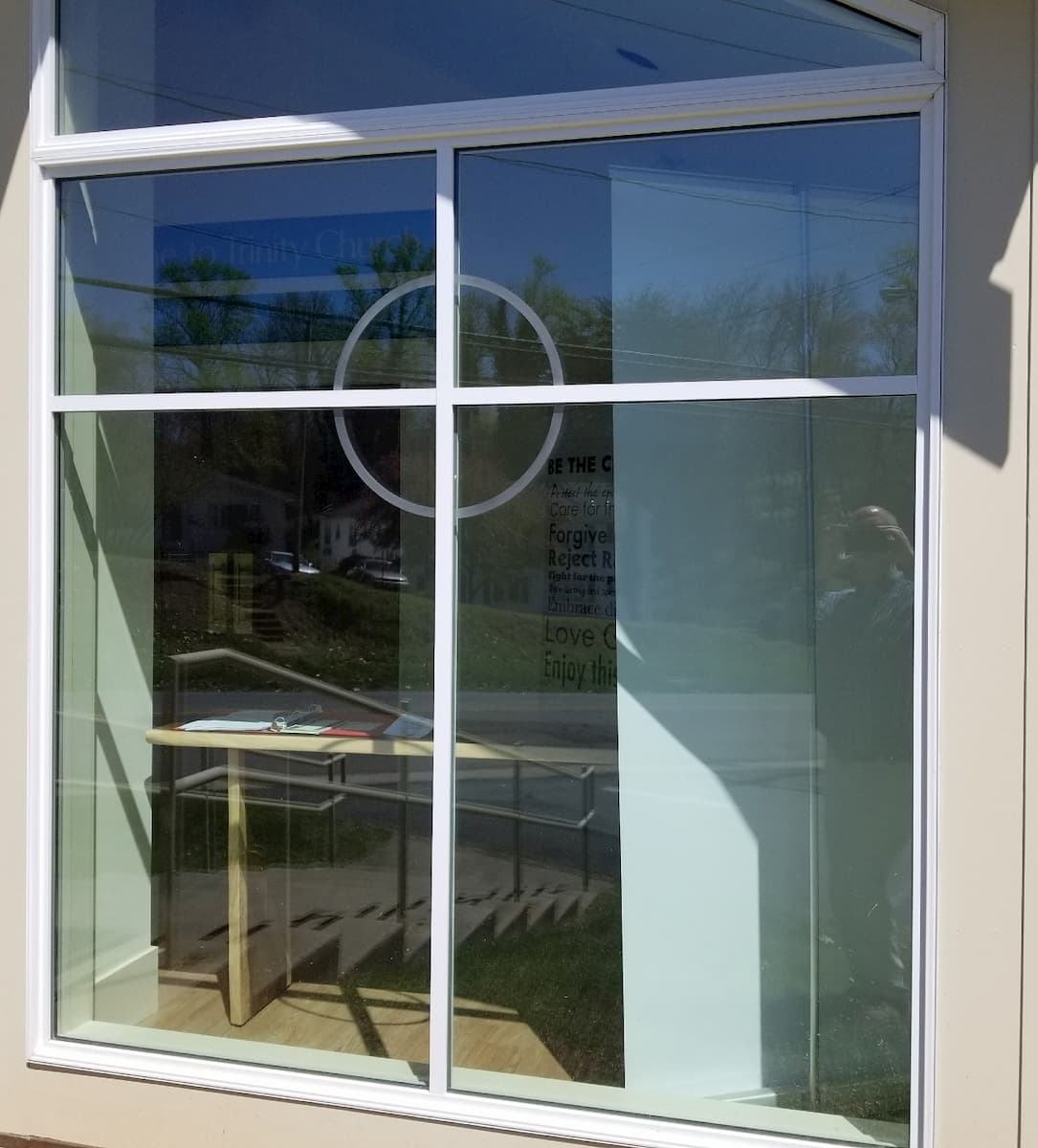 Exterior view of custom wood window with cross grille pattern