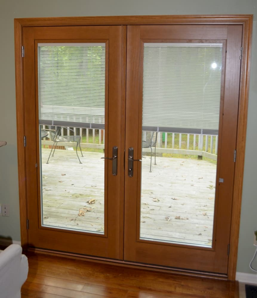 Interior view wood double French doors with between-the-glass blinds