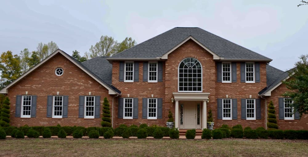 Exterior of brick home with all-new wood windows