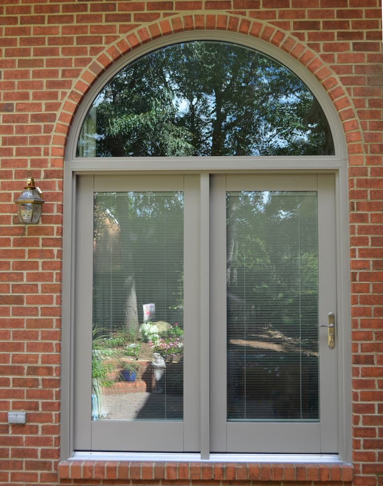 New lifestyle series French patio doors on red brick home