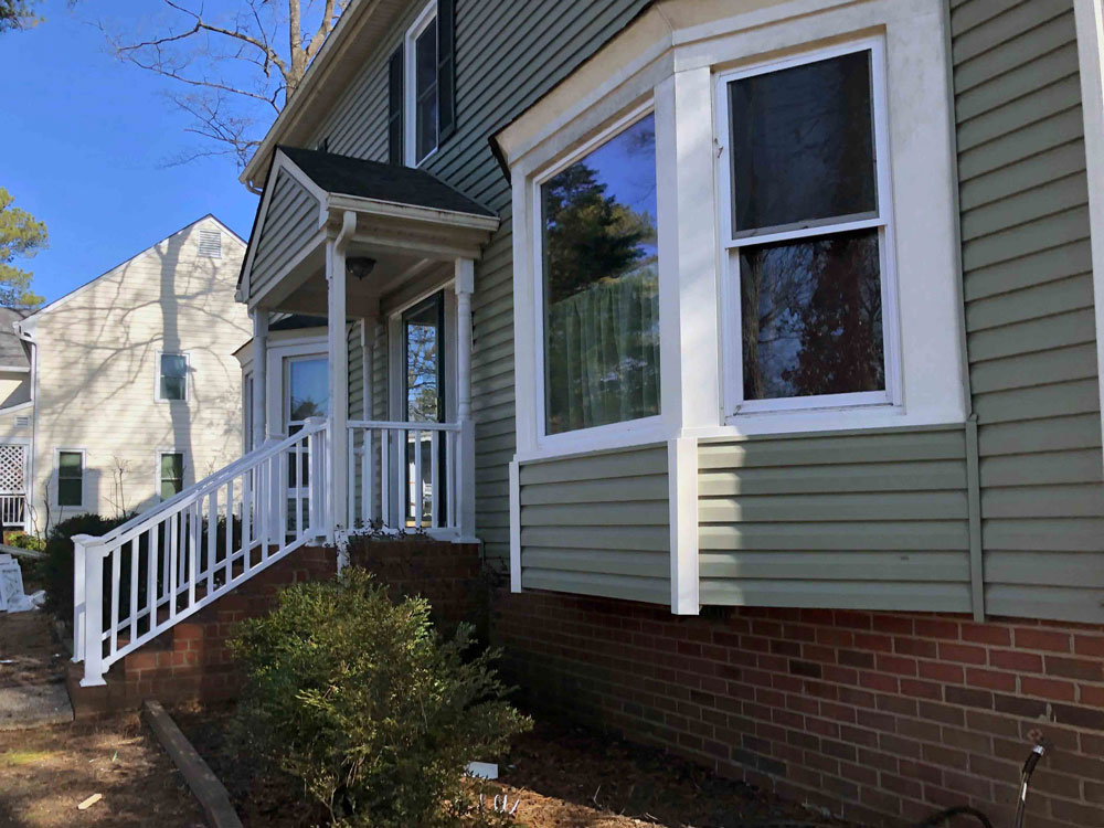 Side view of vinyl double-hung windows in Henrico, VA, whole-home window replacement project