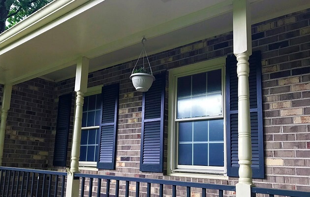 double-hung window replacement on front porch