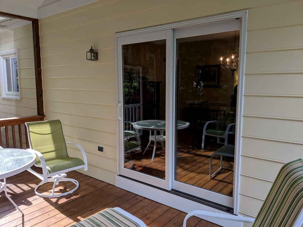 Exterior view of porch with new wood sliding patio doors