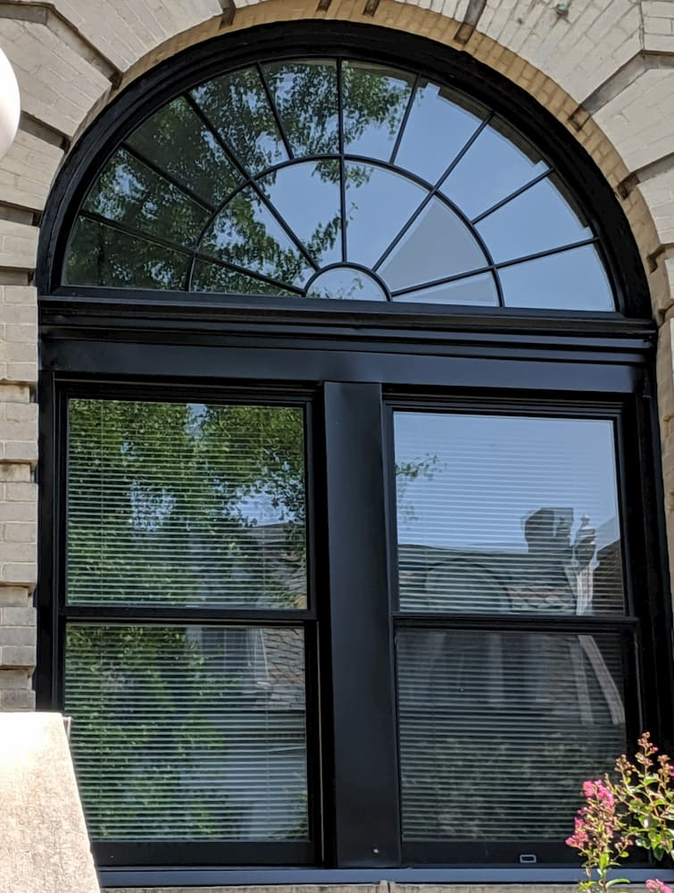 Black wood double-hung windows with half-circle transom