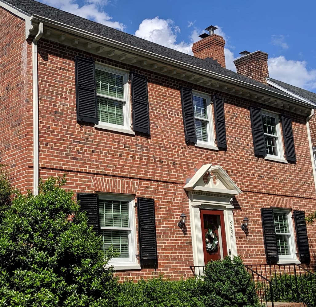 Red brick homes in Richmond with all new wood double-hung windows with traditional grille patterns