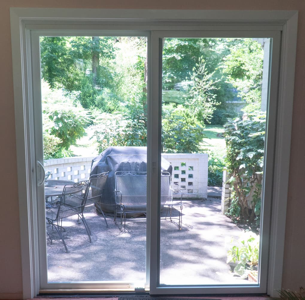 New vinyl sliding patio door with white trim