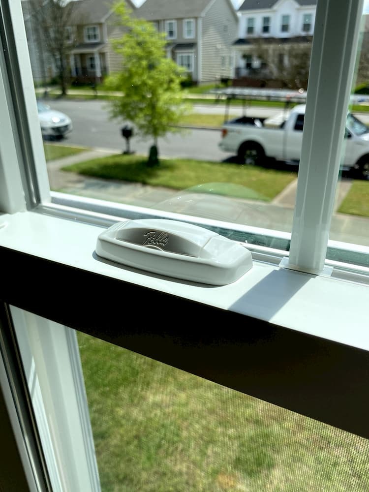 Close up of Pella window hardware on a white window