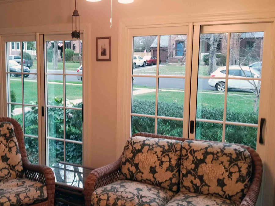 Interior of wall with double wood sliding patio doors in Richmond, VA, home