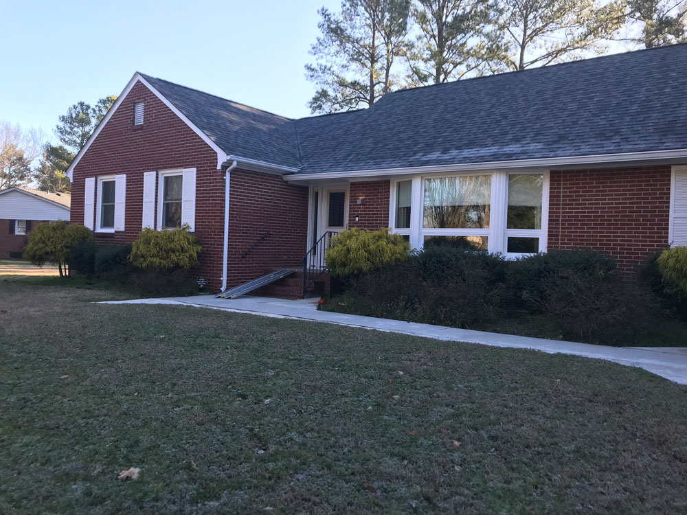 Exterior of Smithfield, VA, home with new vinyl windows and fiberglass entry door system