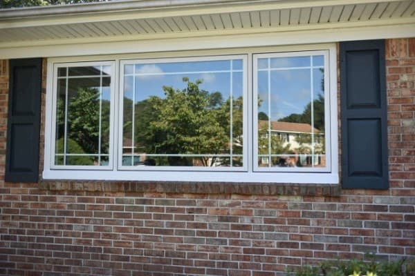 New fiberglass casement windows on red brick home