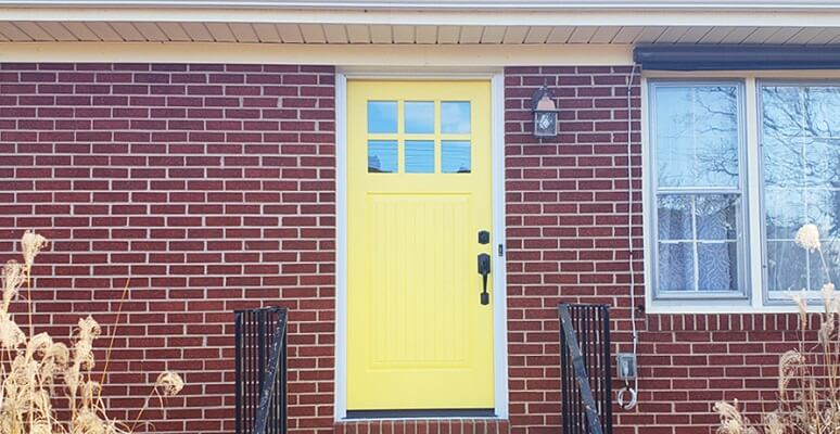 front image of virginia home with new entry door
