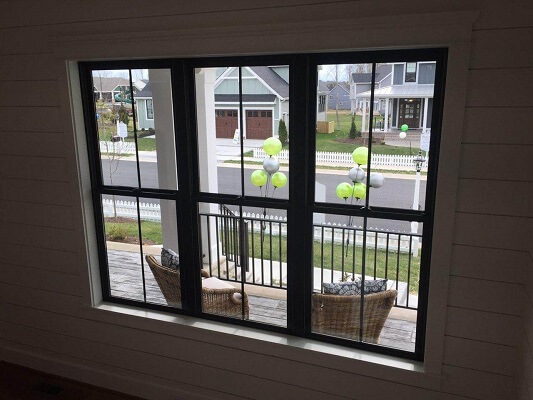 new construction home in richmond virginia gets new black fiberglass double hung windows
