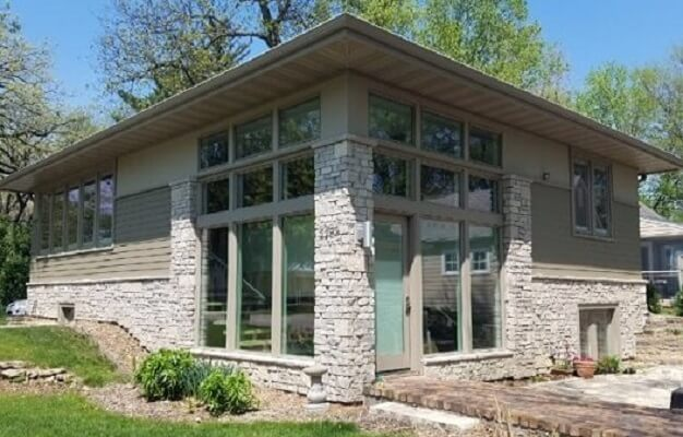 Wood Windows Match Contemporary Stone House