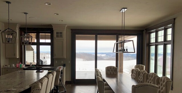 dining room in dubuque home with new wood windows and multi slide patio door