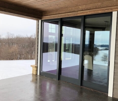 outside view of dubuque home with new wood windows and multi slide patio door