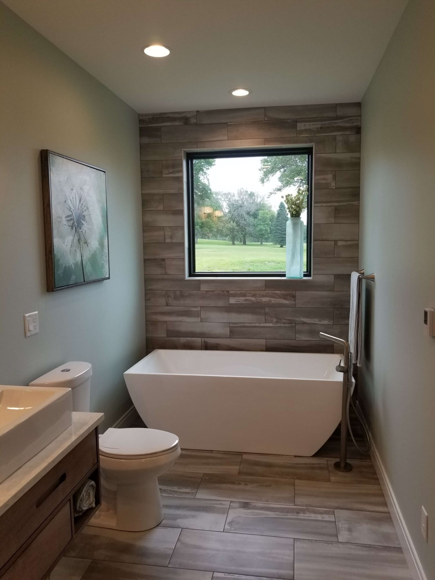bathroom view of waterloo home with new fiberglass casement windows