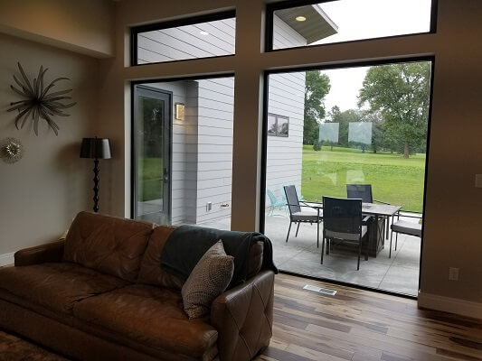 patio view of waterloo home with new fiberglass casement windows