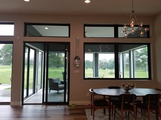 sliding patio door view of waterloo home with new fiberglass casement windows