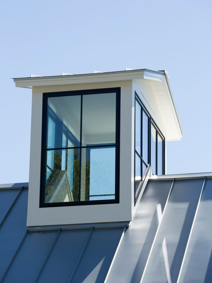 Close-up of large black wood windows on rooftop copulas of home in Williamstown, MA