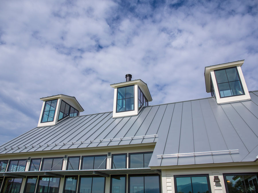 Exterior of large black wood windows on roof of Williamstown, MA, home