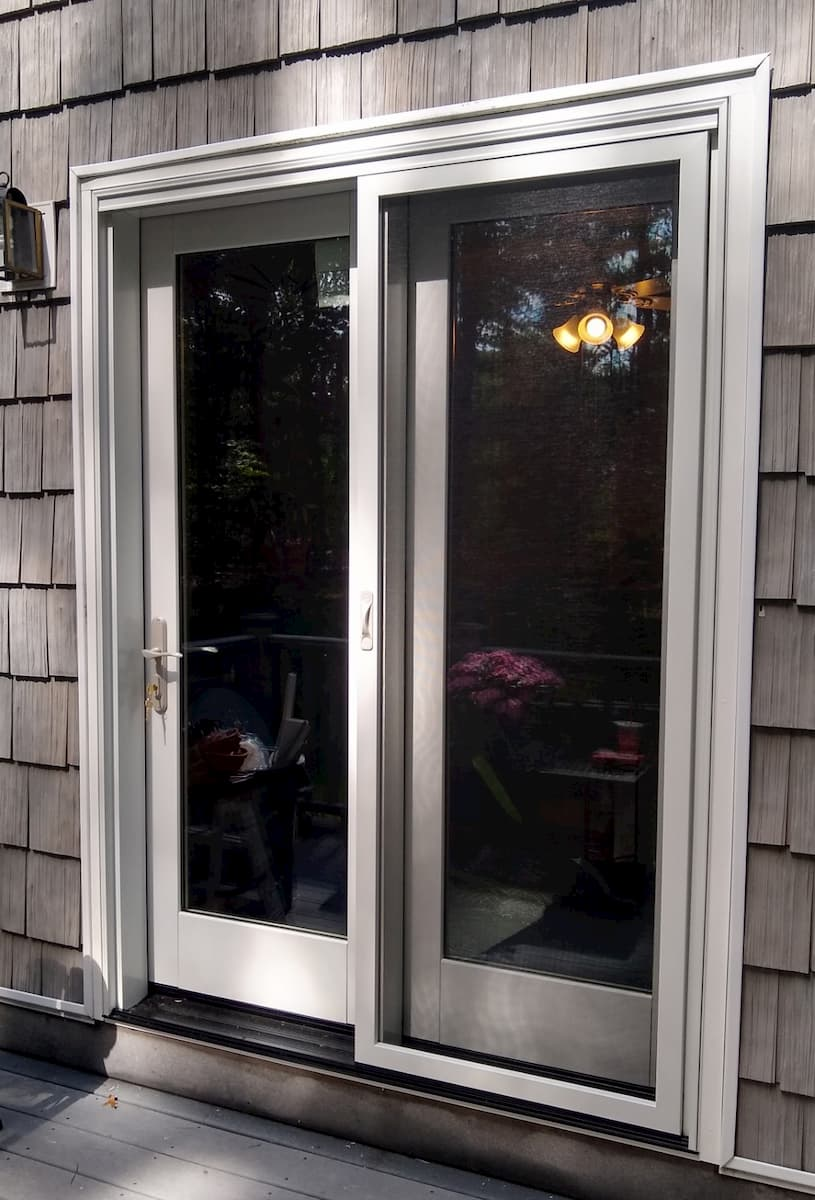 New wood French patio door on shingle-style home
