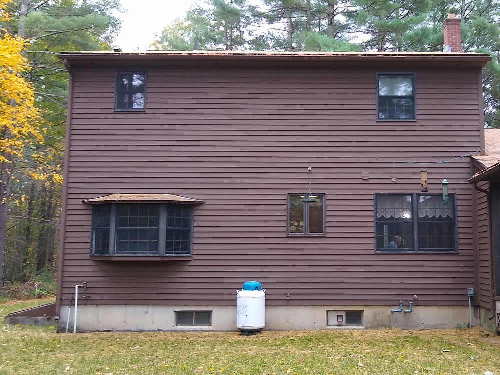 Exterior of back of Southampton, MA, home before whole-home window replacement