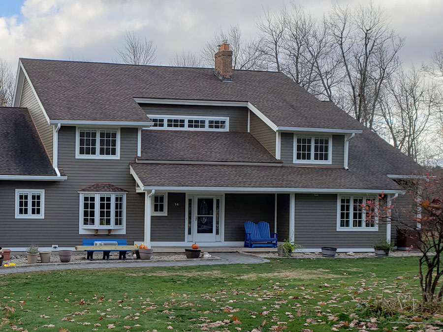 Front exterior view of West Granby, CT, home with new wood windows and a wood front door